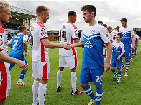 Kenny McEvoy shaking MK Dons hands
