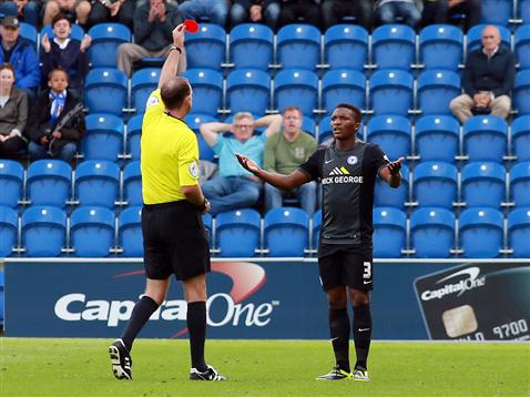 Referee Carl Boyeson shows Kgosi Ntlhe a red card v Colchester
