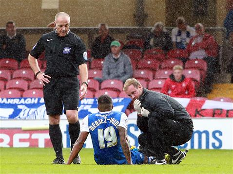 Referee Graham Salisbury watches an injured Nathaniel Mendez-Laing v Bradford