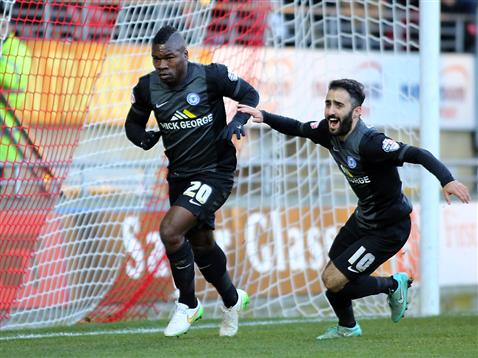 Aaron McLean and Erhun Oztumer celebrate the opening goal v Leyton Orient