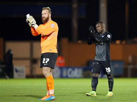 Ben Alnwick and Aaron McLean applaud Posh fans after losing to Colchester