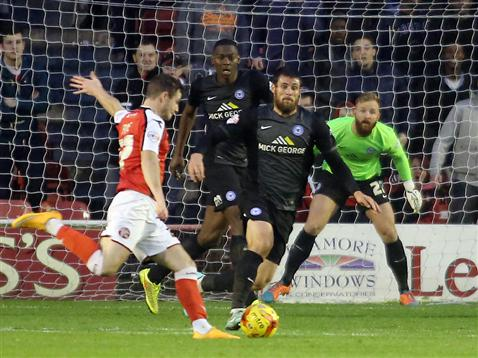 Ben Alnwick and Ricardo Santos watches Michael Bostwick attempt to block a shot v Walsall