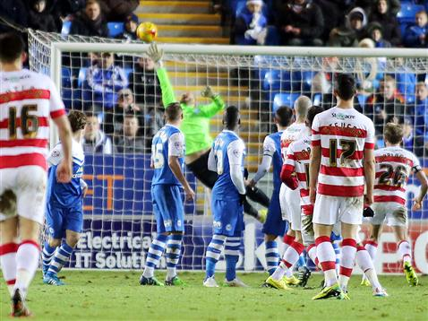 Ben Alnwick fails to touch the ball as Doncaster hit the cross bar