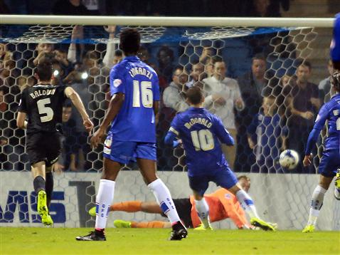 Ben Alnwick just fails to stop Cody McDonald scoring from the penalty spot for Gillingham