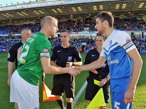 Captain Jack Baldwin shakes hands watched by referee Darren Bond
