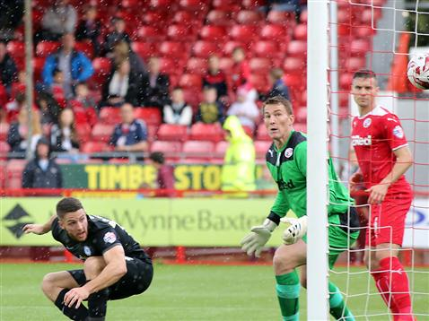 Conor Washington watches the ball go in for goal two v Crawley