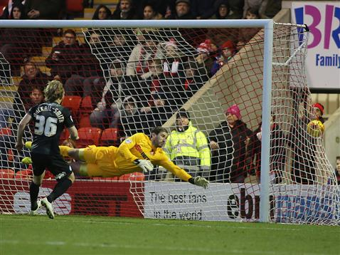 Craig Mackail-Smith watches Erhun Oztumers freekick head to the top corner of the net v Leyton Orient 2