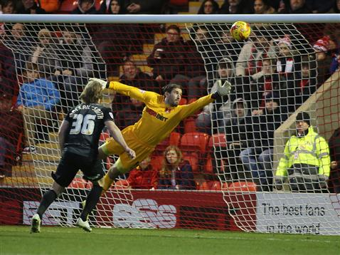 Craig Mackail-Smith watches Erhun Oztumers freekick head to the top corner of the net v Leyton Orient