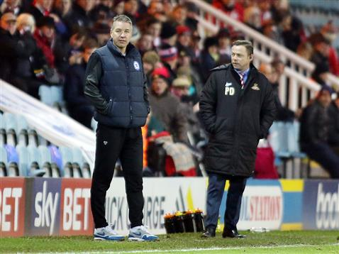 Darren Ferguson watched by Doncasters Paul Dickov