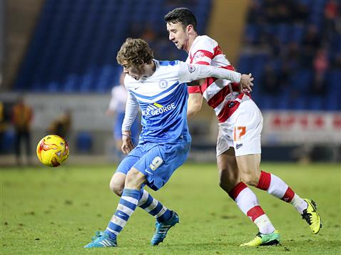 Luke James shields the ball v Doncaster