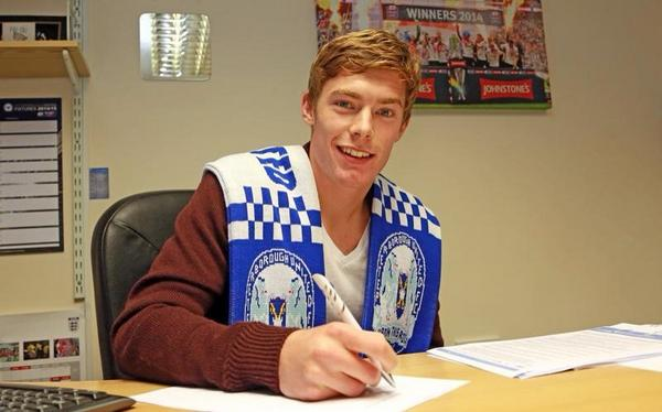 Luke James signing his four year contract