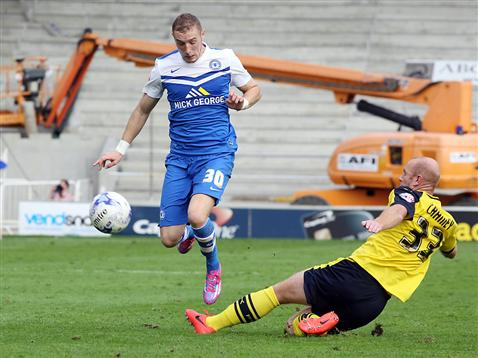 Marcus Maddison skips another lunge by Fleetwoods Crainey