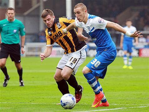 Marcus Maddison v Port Vale being watched by referee James Linington
