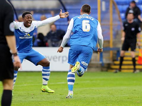 Michael Bostwick celebrates his goal with a jubilant Jermaine Anderson v Oldham