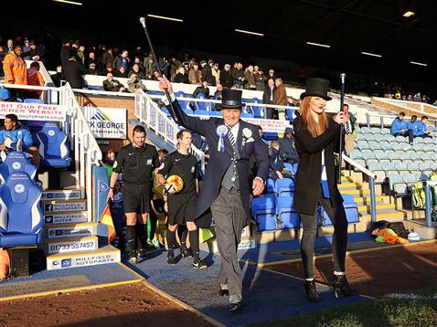 Mr Posh and Miss Posh leads out the teams ahead of referee Jeremy Simpson
