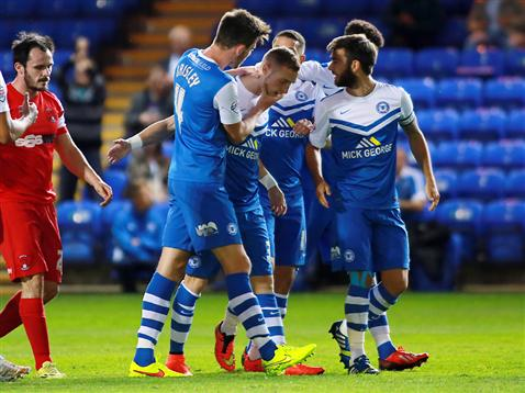 Players congratulate Marcus Maddison on his debut goal v Leyton Orient