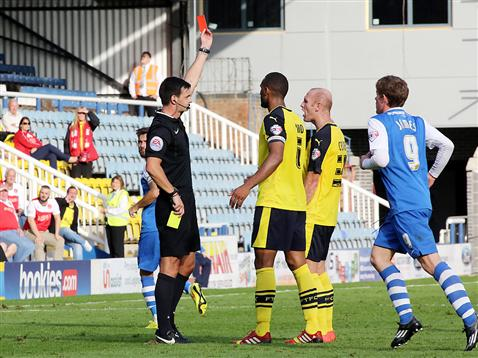 Referee Andy Madley sends off Fleetwoods Crainey v Posh