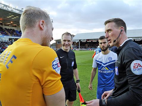 Referee Darren Sheldrake pre-match chat with Posh and Preston captains