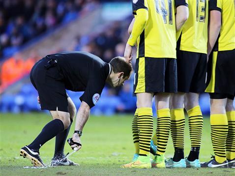 Referee Jeremy Simpson with his magic spray - Posh v Colchester