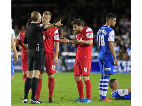 Referee Keith Hill sends off Leyton Orients Romain Vincelot against Posh