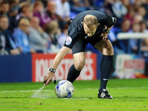 Referee Keith Hill uses the vanishing spray around the ball