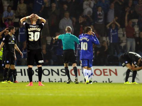 Referee Mark Heywood points to the spot for a Gillingham penalty