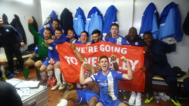 Posh players celebrate their area-final win v Swindon