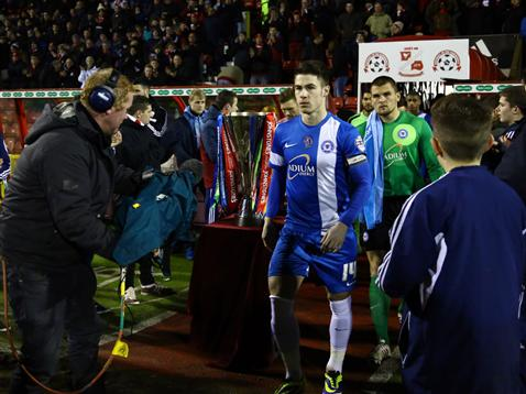 Posh players come out beside the JP Trophy