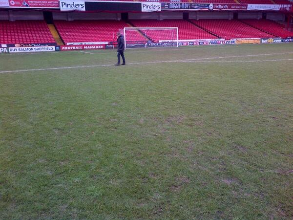 Referee Craig Pawson inspecting the pitch