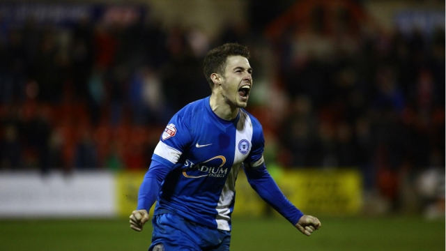 Tommy Rowe celebrates his winning penalty v Swindon