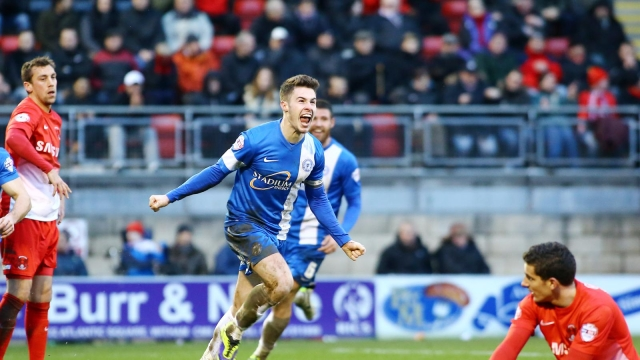 Tommy Rowe celebrates the winner v Leyton Orient