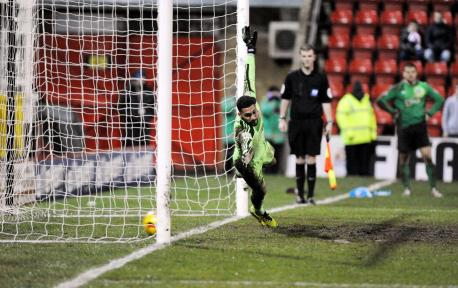 Wes Foderingham cant stop Tommy Rowes winning penalty