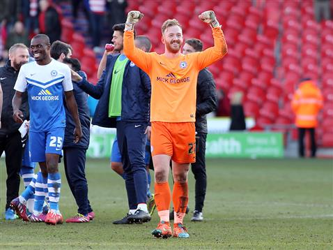 Ben Alnwick celebrates after the game with Gaby Zakuani v Doncaster