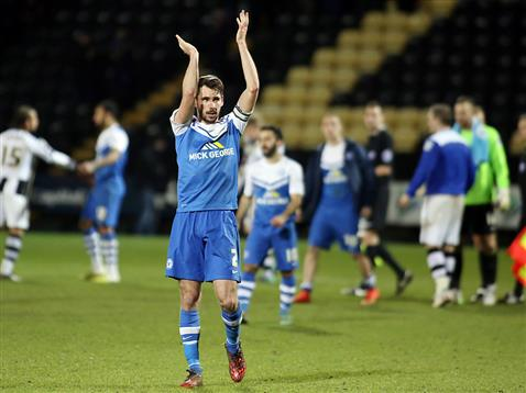 Captain Michael Smith applauds the Posh fans after the win v Notts County