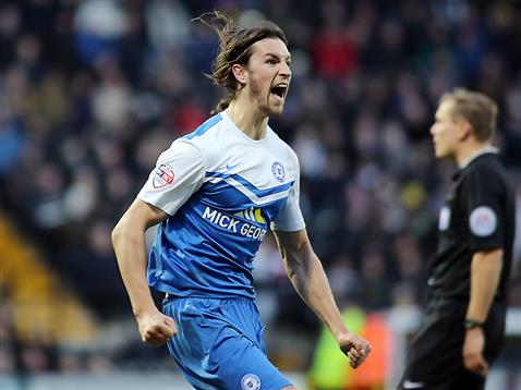 Christian Burgess celebrates scoring the winner v Notts County