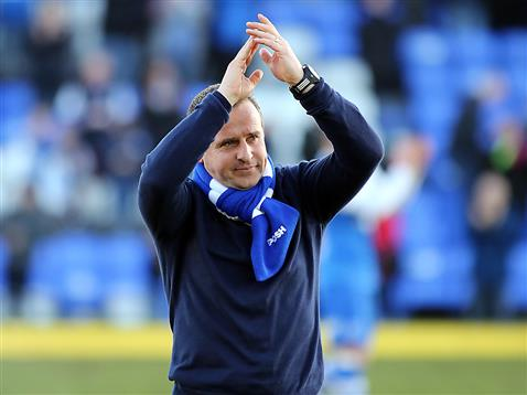 Dave Robertson applauds the fans after his 3rd win in 3 games