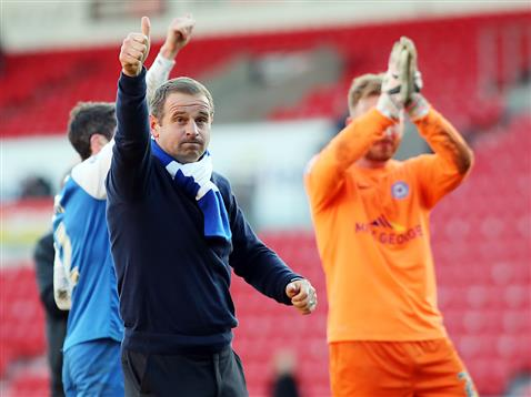 Dave Robertson salutes the Posh fans at Doncaster