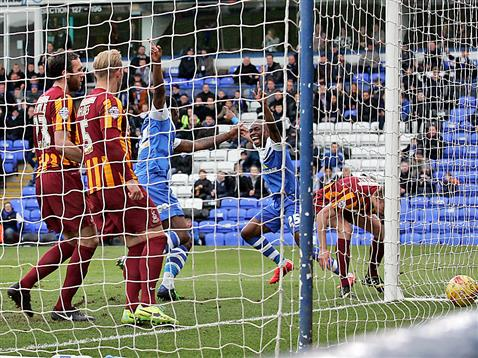 Gaby Zakuani and Ricardo Santos celebrate opening goal v Bradford