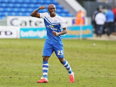 Gaby Zakuani celebrates winning the first match under Dave Robertson v Bradford