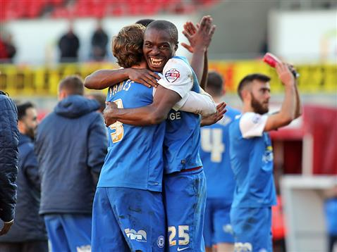 Gaby Zakuani celebrates with Luke James after the win over Doncaster