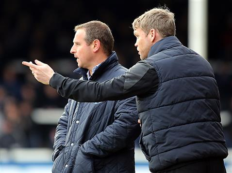 Grant McCann offers advice to Dave Robertson v Bradford