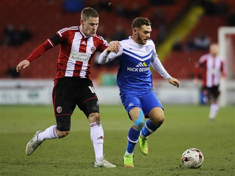 Jon Taylor v Paul Coutts of Sheffield United