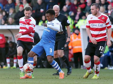 Kgosi Nthle watched by referee Nigel Miller v Doncaster
