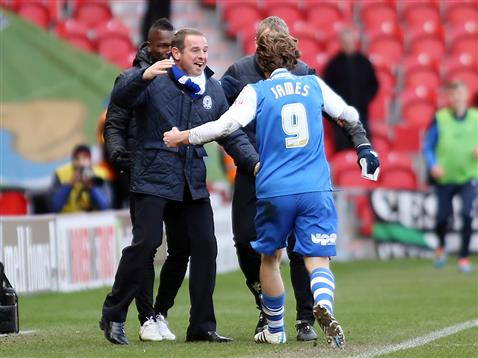 Luke James celebrates with caretaker manager and coaches v Doncaster 2