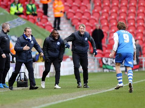 Luke James celebrates with caretaker manager and coaches v Doncaster