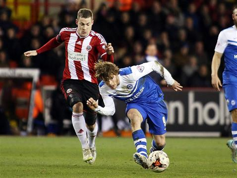 Luke James v Paul Coutts of Sheffield United