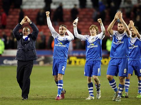 Michael Bostwick and Michael Smith celebrate the win over Sheff Utd with other players