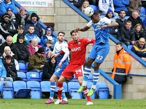 Ricardo Santos heads the ball away watched by Michael Smith v Chesterfield