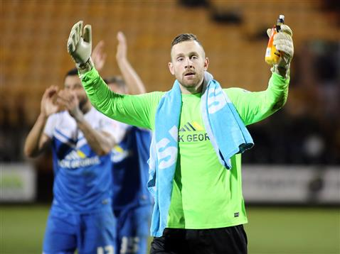 Scott Loach applauds the Posh fans after the win v Notts County