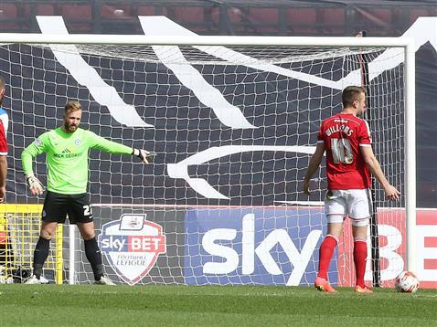 Ben Alnwick faces a penalty v Swindon